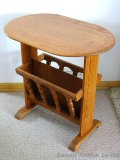 Solid wood side table with magazine/book storage underneath. Table is sturdy and in good shape.