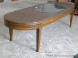 Nice sturdy coffee table is in great condition and measures approx. 5' x 20