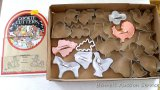 Vintage aluminum and other cookie cutters - all in good shape. Plus a few recipes. Largest is