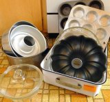 Vintage refrigerator pan with muffin tins, Bundt pan, round cake pans, glass pie plates, covered