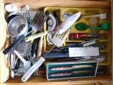 Kitchen utensils including spatulas, funnels, mashers, ladle, knives, nut crackers, coffee scoops,