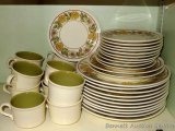 Daisy patterned dishes are unmarked, cups are marked 'USA'. Includes 11 dinner plates, two salad
