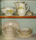 Daisy pattern serving bowls, pitcher; One serving bowl advertises 'Kostner Bros. Medford, Wis.';