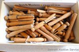 Cigar box filled with heavy duty old wooden clothespins. Box measures 9