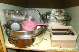 Spring form pan, tube pan, Pyrex four cup measure, mixing bowls, cake decorating tips, cookie press,