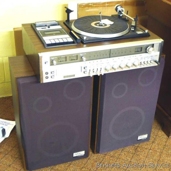 Zenith stereo system incl. turntable, cassette player, eight track player, AM/FM radio and two