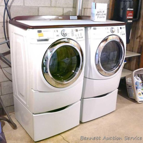 Maytag 5000 Series washer and dryer with storage bases and work top. Washer Model MHWE550WW01, dryer