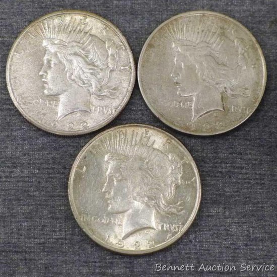 Three silver Peace dollars including 1922, 1922-S, 1922-D.
