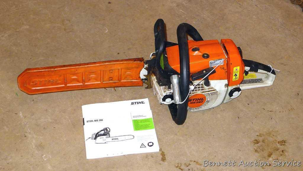 "Stihl MS 260 chainsaw with 16"" bar, bar cover, manual and wrench. Grip safety was wrapped with tape"