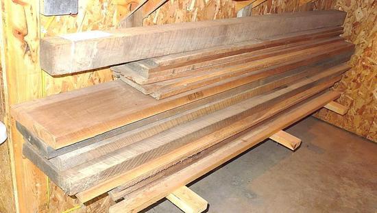 "Impressive stack of black walnut. Largest board is 11-1/2"" x 8/4 x 98"". Great for gun stocks."