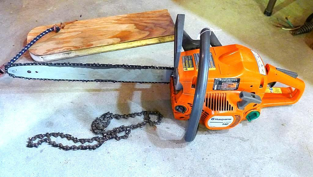 "Husqvarna 142 E Series chain saw with 16"" bar. Seller says it runs."