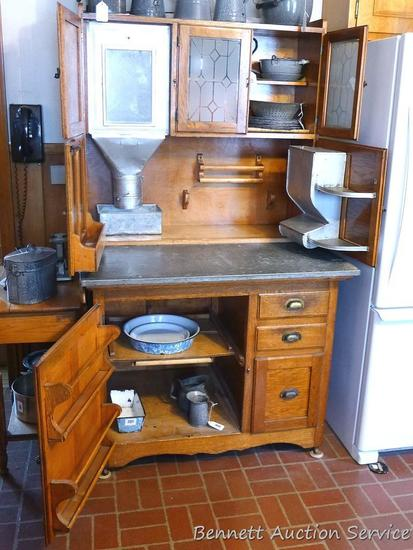 Beautiful antique Hoosier-style kitchen cabinet has flour sifter and metal lined drawer with vented