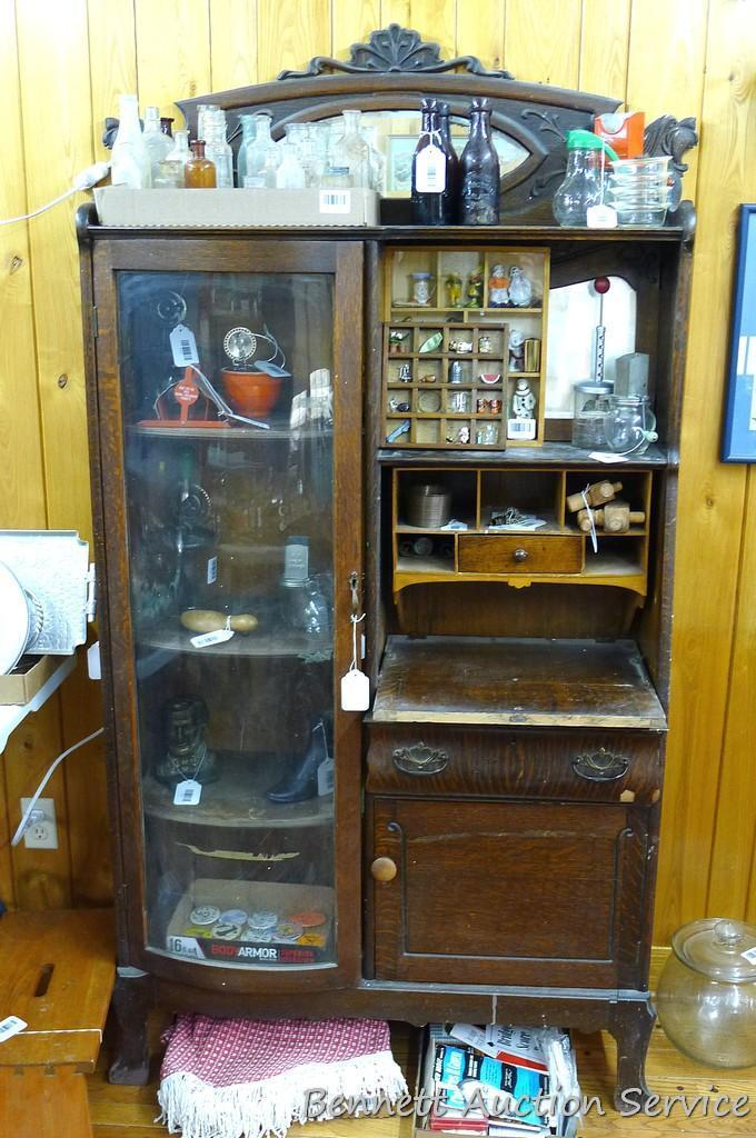 Beautiful secretary desk with rounded glass door on the left hand side; has 2 doors on the right