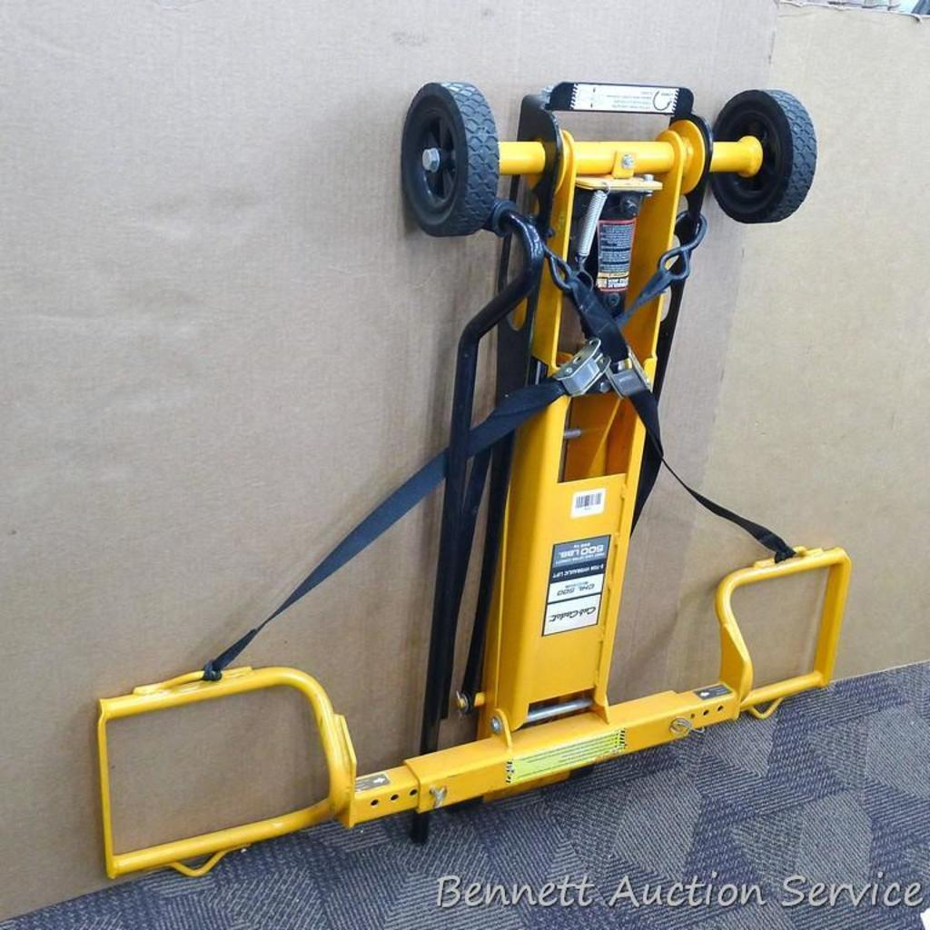 """Cub Cadet two ton hydraulic lift, appears to be new. Measures approx. 48""""x 40""""."""