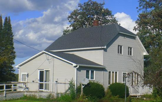 Northern WI country home with huge outbuilding.  Beautifully surrounded by fields and forest.