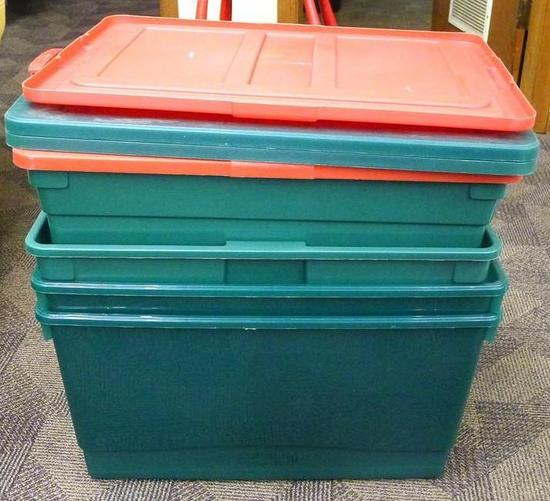 "Four Rubbermaid totes with lids, three are 12"" tall and one is about 9"" tall. Comes with cardboard"
