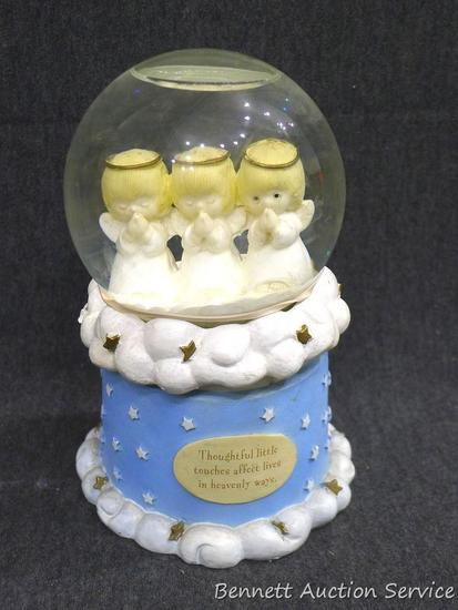 "Hallmark snowglobe holds angels and stands about 7"" tall. Top comes out of bottom. A couple small"