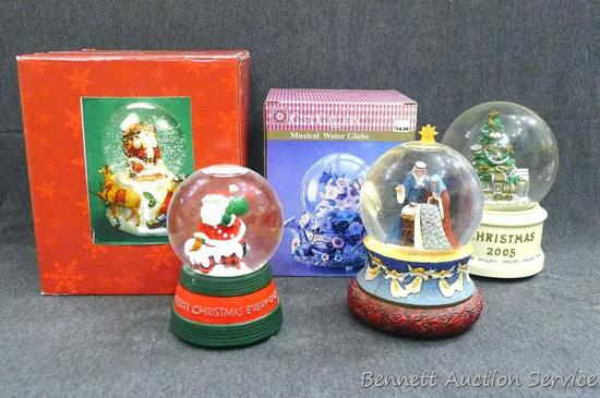 "Several snow globes up to 7"" tall. Look to be in fine condition."