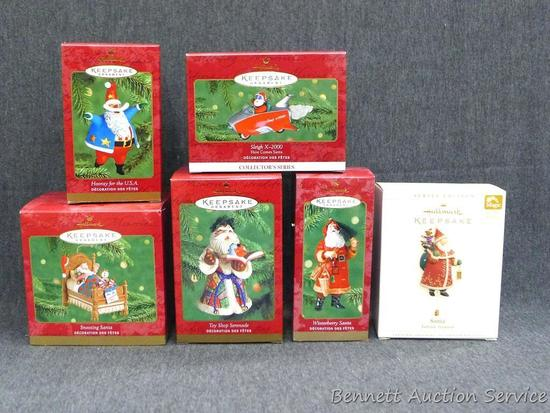 "Hallmark Keepsake ornaments are all Santa themed. Tallest box is about 5-1/2"" tall."