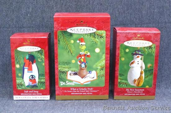 Three Hallmark Keepsake ornaments include The Grinch. All are wrapped in bubble; tallest box is 6""