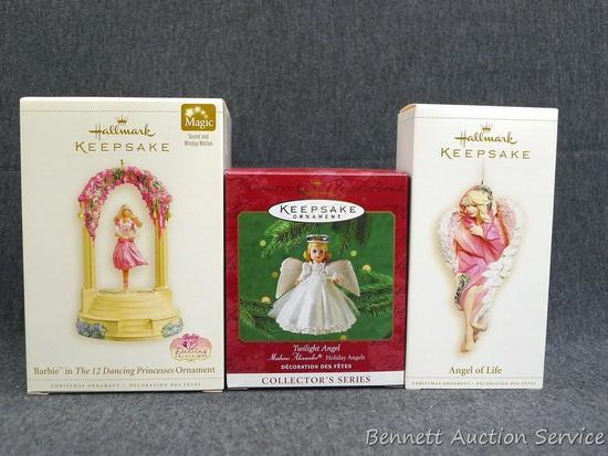 "Three Hallmark Keepsake ornaments includes Barbie. Taller boxes are about 6"". Come with packaging."