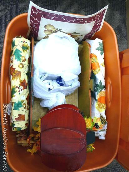 "Tote with lid holds table cloths, faux leaves and pumpkin decorations. Tote is about 15"" tall."