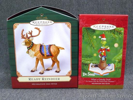 Hallmark Keepsake ornaments include The Grinch. One is wrapped in bubble, the other in original