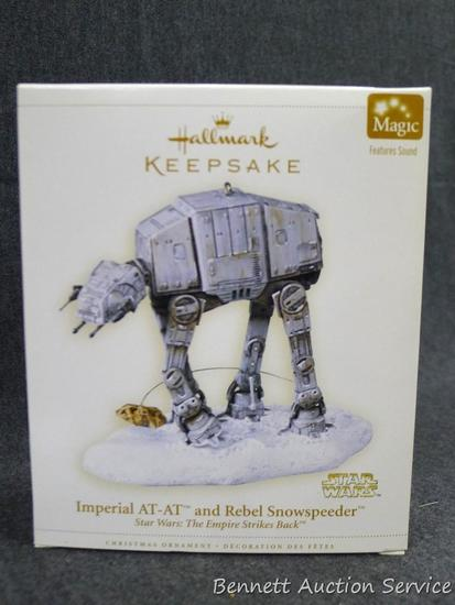 "Hallmark Imperial AT-AT and Rebel Snowspeeder Star Wars ornament comes in packaging. Box is 6"" tall."