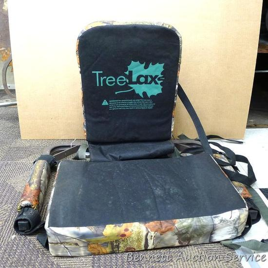 "Tree Lax metal framed, portable tree seat is 24"" x 20"" x 22"" tall includes hold down straps and"