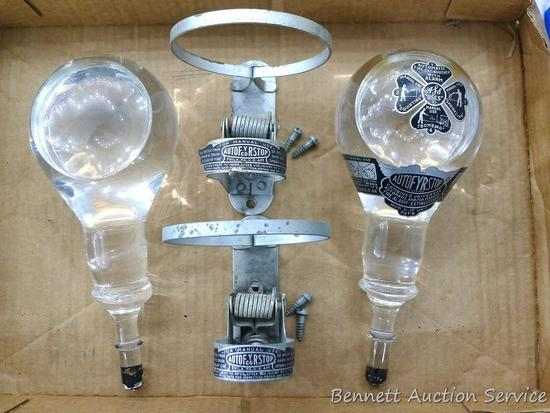 Two vintage AutoFRYStop glass fire extinguishers come with mounting brackets. Glass part measures