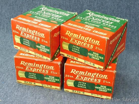 Three full and one partial boxes Remington Express 20 gauge shot shells. Partial box is missing 2 or