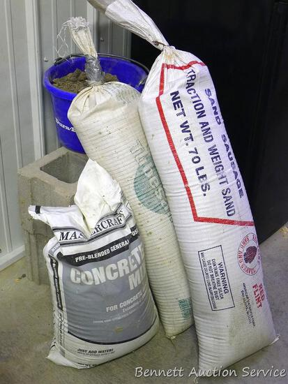 "Two 70 lb. tubes of traction sand, 32"" long; Two cement blocks, 15-1/2"" x 8"" x 6""; Bag of concrete"