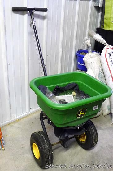John Deere broadcast spreader comes with a removable see-through cover. Overall in nice shape.
