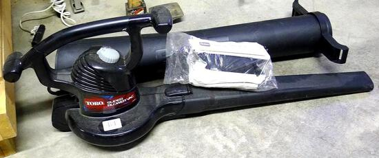 Toro Electric Super Blower/Vac is in good condition and includes manual, bag and attachments. Runs.