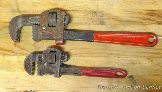 "Two pipe wrenches. Largest is 14"", jaws are in good shape. One is 10"" made in Spain."