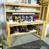 Nicely made homemade wooden work bench is sturdy and measures 72