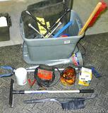 Tote filled with automotive items including filters, battery charger, flexible funnel, ice scrapers,