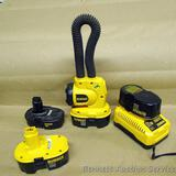 DeWalt 18V rechargeable light with 3 batteries and charger. All work.