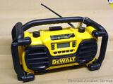 DeWalt Heavy Duty Work Site Charging Station/Radio model DC012. Has instruction manual. Works.