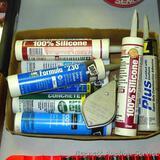 No shipping. Five unopened and four opened tubes of various sealers, caulk and adhesive, plus a