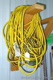 Heavy duty extension cord is approx. 100' long and has triple receptacle end. Looks like approx.