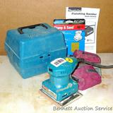 Makita Model BO4552 finishing sander comes with dust collector bag, case, manual and extra sand
