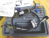 Dremel Multi-Pro Rotary tool with instructions and carry case. Comes with sanding and grinding drums