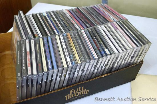Box of CDs incl Wayne Jennings, Conway Twitty, Toby Keith, Vince Gill, Clint Black, Randy Travis,