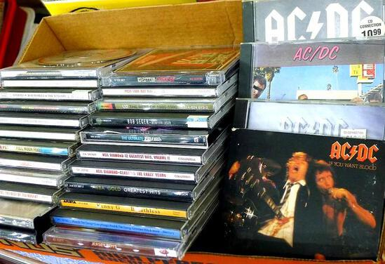 Box of CD's including Bob Dylan, Kenny G., Neil Diamond, Bob Seger, Led Zeppelin, AC/DC and more.
