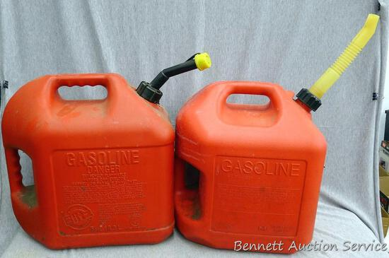Two 5 gallon gas totes with spouts.