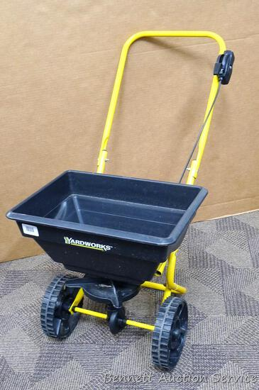"""YardWorks broadcast spreader has 11 settings and bucket measures approx. 18"""" x 13"""". Good condition."""