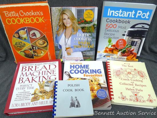 Stack of cook books for the chef in the family. Topics include Instant Pot, Trisha Yearwood, Polish