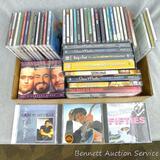 Assortment of CDs includes Elton John, Jimmy Buffet, Stevie Wonder, John Denver, Isaac Hayes and