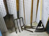 Pitch fork, grass trimmer, hand rake, hand hoe and spade shovel.